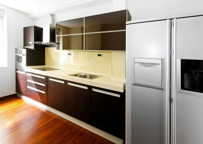 Interior of contemporary kitchen with dark counter