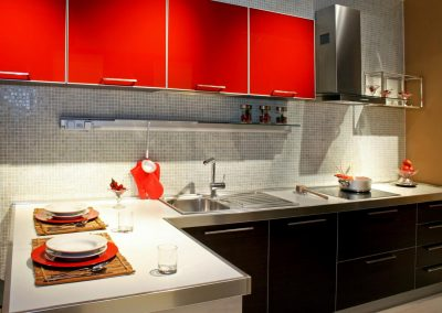 Modern kitchen counter with red details and lobster
