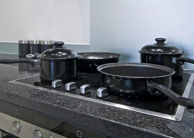 four ring induction electric hob wit pan and pots
