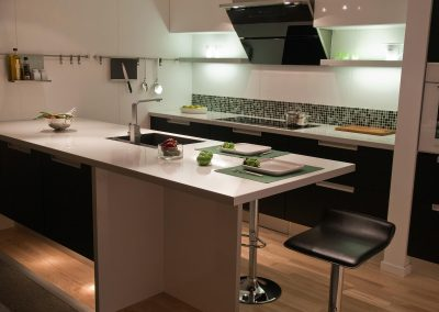 Modern design trend kitchen with black wood elements and metal