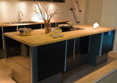 Modern clean design trendy kitchen made of black wooden elements