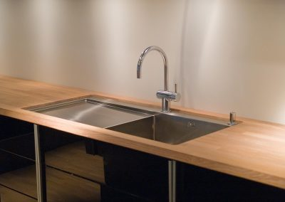 Details of modern design trendy  kitchen sink with water tap faucet