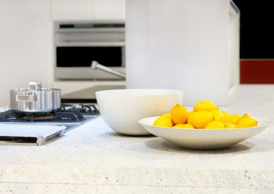 Yellow lemons in bowl at kitchen counter